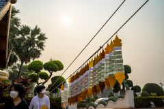 Chiang Mai/Thailand - March 16, 2019: Tourists are wearing masks while visiting a Buddhist temple during extreme air pollution. royalty free stock photography