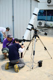 Unidentified man learn to take photo with telescope Stock Image