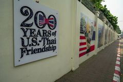 Chiang Mai / Thailand - March 12, 2019 : The yellow wall of the U.S. Embassy with the sign of 200 years of U.S.-Thai Friendship an royalty free stock images