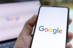 Free CHIANG MAI, THAILAND - May.26,2019: Man Holding Xiaomi Mi Mix 3 With Google Search On Screen. Royalty Free Stock Photography - 159579107