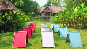 Drying colorful paper in Poopoopaper park, Chiang Mai, Thailand. CHIANG MAI, THAILAND - MAY 5, 2019: The forms with wet colorful paper, made of elephant poop stock video