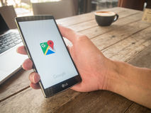 CHIANG MAI, THAILAND - MAY 07, 2016: Man hand holding LG G4 with. Google Maps application o. Google Maps is a service that provides information about Royalty Free Stock Images