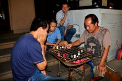 Chiang Mai, Thailand: Men Playing Chess Royalty Free Stock Photo