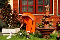 Chiang Mai, Thailand: Monk Gardening at Temple Stock Image