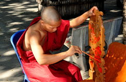 Chiang Mai, Thailand: Monk Painting Window Tracery Stock Photos