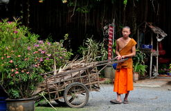 Chiang Mai, Thailand: Monk with Wheelbarrow Royalty Free Stock Photos