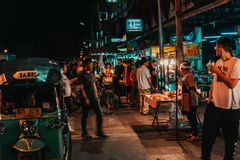 Chiang Mai, Thailand 12.16.18: Night market in the streets of Chiang Mai. Vendor sell his goods in the streets. stock images