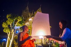 Chiang Mai Yee Peng festival. CHIANG MAI , THAILAND - NOV 03 : Buddhist monk launch sky lantern during Yee Peng festival in Chiang Mai , Thailand on November 03 Stock Images