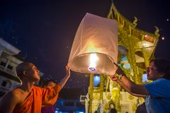Chiang Mai Yee Peng festival. CHIANG MAI , THAILAND - NOV 03 : Buddhist monk launch sky lantern during Yee Peng festival in Chiang Mai , Thailand on November 03 Royalty Free Stock Image