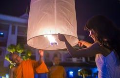 Chiang Mai Yee Peng festival. CHIANG MAI , THAILAND - NOV 03 : Buddhist monk launch sky lantern during Yee Peng festival in Chiang Mai , Thailand on November 03 Royalty Free Stock Photos