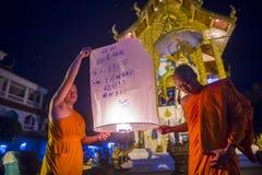 Chiang Mai Yee Peng festival. CHIANG MAI , THAILAND - NOV 03 : Buddhist monks launch sky lantern during Yee Peng festival in Chiang Mai , Thailand on November 03 Royalty Free Stock Photo