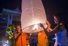 Chiang Mai Yee Peng festival. CHIANG MAI , THAILAND - NOV 03 : Buddhist monks launch sky lantern during Yee Peng festival in Chiang Mai , Thailand on November 03 Stock Photography