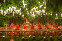Loy Kratong Festival, Buddhist monk fire candles to the Buddha and floating lamp on in Phan Tao Temple, Chiangmai, Thailand. royalty free stock images
