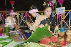 Women make Krathong flower bowls with banana leaves during Loi Krathong celebration at ningt in Chiang Mai, Thailand. Stock Images