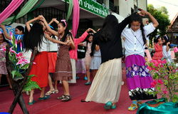Chiang Mai, Thailand: School Girls Dancing. A group of young school girls performing traditional Thai dances during an assembly at their school on Chang Puak Royalty Free Stock Photography