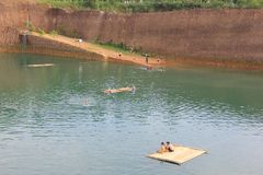 Hangdong canyon chiangmai. Resevoir from old excavation laterite soil for sale. CHIANG MAI, THAILAND -SEPTEMBER 9 2015: Hangdong canyon chiangmai. Resevoir from stock photo