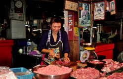 Chiang Mai, Thailand: Woman Chopping Pork Royalty Free Stock Images