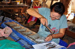 Chiang Mai, Thailand: Woman Tinsmith at Work Royalty Free Stock Photos