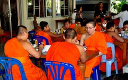 Chiang Mai, Thailand: Young Monks Dining at Wat Suan Dok Royalty Free Stock Images