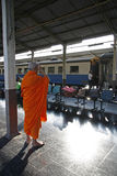 Chiang Mai train station. A Buddhist monk waits for his train at Central Train Station in Chiang Mai, Thailand Royalty Free Stock Photography