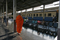 Chiang Mai train station. A Buddhist monk waits for his train at Central Train Station in Chiang Mai, Thailand Stock Photo