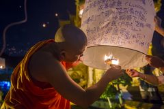 Chiang Mai Yee Peng festival. CHIANG MAI , THAILAND - NOV 03 : Buddhist monk launch sky lantern during Yee Peng festival in Chiang Mai , Thailand on November 03 Royalty Free Stock Images