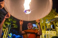 Chiang Mai Yee Peng festival. CHIANG MAI , THAILAND - NOV 03 : Buddhist monk launch sky lantern during Yee Peng festival in Chiang Mai , Thailand on November 03 Stock Photo