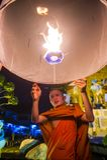 Chiang Mai Yee Peng festival. CHIANG MAI , THAILAND - NOV 03 : Buddhist monk launch sky lantern during Yee Peng festival in Chiang Mai , Thailand on November 03 Royalty Free Stock Photography