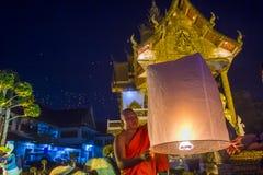 Chiang Mai Yee Peng festival. CHIANG MAI , THAILAND - NOV 03 : Buddhist monk launch sky lantern during Yee Peng festival in Chiang Mai , Thailand on November 03 Stock Photos