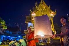 Chiang Mai Yee Peng festival. CHIANG MAI , THAILAND - NOV 03 : Buddhist monk launch sky lantern during Yee Peng festival in Chiang Mai , Thailand on November 03 Stock Photography