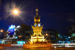 CHIANG RAI-DEC 17: Light trails on street around golden clock tower, established in 2008 by Thai visual artist Chalermchai Kositpi Stock Photos