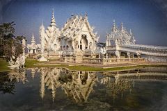 Chiang Rai Temple. In Thailand with a reflection of the temple in the garden water Stock Image