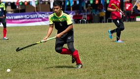 Outdoor Hockey. Hockey player in action during the Thailand National Games stock photo