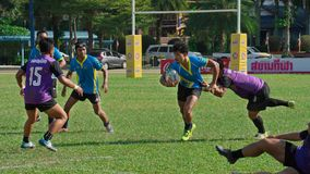 Rugby player making a service at Thailand National Games, 2018 Chiang Rai Games. stock photography
