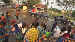 People funny playing water at Suan Tung Lae Khom Chiang Rai Park in Songkran day stock video