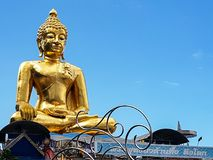 A big golden statue of Buddha. Chiang Rai, Thailand - 01 August 2017: Large golden Buddha statue with blue sky in a sunny day stock photos