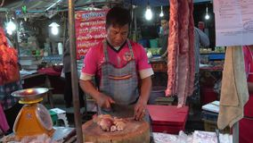 The seller of meat in the street food market. Chiang Rai, Thailand