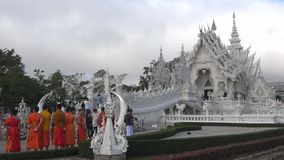 Young Buddhist monks at the White temple Wat Rong Khun. Chiang Rai, Thailand. Chiang Rai, Thailand - December 16, 2018: Young Buddhist monks at the White temple stock video footage
