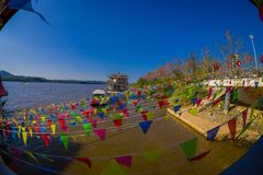 CHIANG RAI, THAILAND - FEBRUARY 01, 2018: Above view of dozens of flags hangings in the pier at golden triangle Laos. Over a river, in Thailand Stock Image