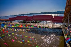 CHIANG RAI, THAILAND - FEBRUARY 01, 2018: Above view of dozens of flags hangings in the pier at golden triangle Laos. Over a river, in Thailand Stock Photography
