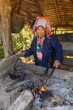 Akha woman with traditional clothes and silver jewelery working in smithy, Northern Thailand. Chiang Rai, Thailand - February 8, 2017: Akha woman with Royalty Free Stock Photos