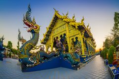 CHIANG RAI, THAILAND - FEBRUARY 01, 2018: Beautiful outdoor view at the enter, close to a dragon figure of Rong Sua Ten. Blue temple with blue sky, Chiang Rai Stock Photos