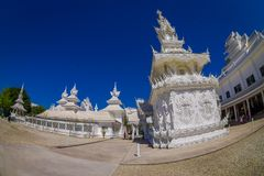 CHIANG RAI, THAILAND - FEBRUARY 01, 2018: Beautiful white temple at backyard in Thailand : Chiangmai Wat pun tao. Fish eye effect Royalty Free Stock Image