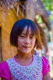 CHIANG RAI, THAILAND - FEBRUARY 01, 2018: Close up of unidentified smiling little girl belongs to a Karen Long Neck hill stock photography