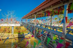 CHIANG RAI, THAILAND - FEBRUARY 01, 2018: Outdoor view of dozens of flags hangings in the pier at golden triangle Laos. In Thailand Royalty Free Stock Image