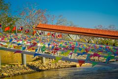 CHIANG RAI, THAILAND - FEBRUARY 01, 2018: Outdoor view of dozens of flags hangings in the pier at golden triangle Laos. In Thailand Stock Image