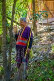 CHIANG RAI, THAILAND - FEBRUARY 01, 2018: Outdoor view of unidentified old woman walking in tropical rainforest in. Chiang Mai Province, Thailand Stock Photos