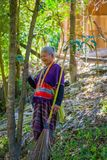 CHIANG RAI, THAILAND - FEBRUARY 01, 2018: Outdoor view of unidentified old woman walking in tropical rainforest in. Chiang Mai Province, Thailand Stock Photography