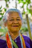 CHIANG RAI, THAILAND - FEBRUARY 01, 2018: Portrait of unidentified old woman walking in tropical rainforest in Chiang. Mai Province, Thailand Royalty Free Stock Images