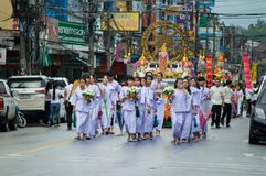 Thai people hold an offering and paraded around Chiang Rai town. Stock Photography